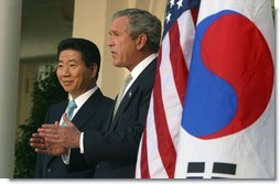 President George W. Bush and South Korean President Roh Moo-hyun in the Rose Garden on May 14, 2003.  White House photo by Paul Morse