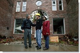 """President George W. Bush comforts Scott and Annette Rector in front of their destroyed business in Pierce City, Mo., Tuesday, May 13, 2003. """"You can't realize what it's like to see a tornado go right down the main street of a town and just wipe it out,"""" said President Bush as he surveyed the damage from tornados that ripped through southwestern Missouri May 4. """"It's hard to envision. But a lot of people know you're suffering, and a lot of people are praying for you, and a lot of people care for you. And a lot of people wish you all the best.""""  White House photo by Susan Sterner"""