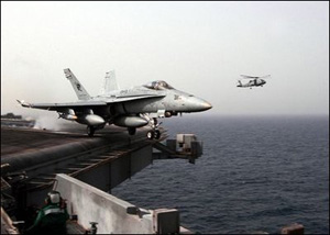 """The Arabian Gulf (Mar. 20, 2003) -- An F/A-18C Hornet assigned to the """"Stingers"""" of Strike Fighter Squadron One One Three (VFA 113) launches from the flight deck aboard the aircraft carrier USS Abraham Lincoln (CVN 72).U.S. Navy photo by Photographer's Mate 3rd Class Philip A. McDaniel"""