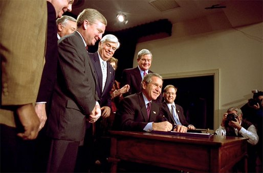 """President George W. Bush signs H.R. 3295, Help America Vote Act of 2002, into law in the Dwight D. Eisenhower Executive Office Building Tuesday, Oct. 29. The legislation authorizes 3.9 billion dollars for improvements in state and local election systems. """"Each state will be required to maintain a clean and current and accurate state -- statewide list of registered voters, making it easier to register and easier to detect fraud,"""" explained the President. White House photo by Paul Morse."""