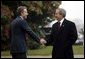 President George W. Bush is greeted by British Prime Minister Tony Blair at Hillsborough Castle near Belfast, Ireland, April 7, 2003. White House photo by Paul Morse.