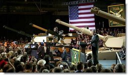 """President George W. Bush addresses employees of the Lima Army Tank Plant, where the Abrams M1A2 tank is built, in Lima, Ohio, April 24, 2003. """"I'm here to thank you all for your service to our country, and thank you for the vital contribution you have made to peace and freedom,"""" said the President in his remarks. """"And each of you have had a part in this mission. Each of you are a part to making sure this country is strong enough to keep the peace.""""  White House photo by Paul Morse"""