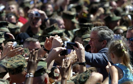 President George W. Bush greets Marines and their families after speaking at Camp Lejeune in Jacksonville, N.C., Thursday, April 3, 2003. White House photo by Paul Morse