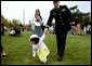 A tiny Easter egg toddler leads the charge at the White House Easter Egg Roll Monday, April 21, 2003. About 12,000 U.S. military families came to the South Lawn to race with Easter Eggs, play games, and listen to children's stories.