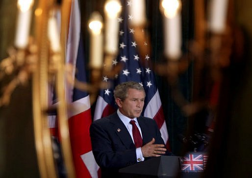 President George W. Bush is reflected in a mirror during a press conference with British Prime Minister Tony Blair at Hillsborough Castle near Belfast, Northern Ireland, Tuesday, April 8, 2003. White House photo by Paul Morse