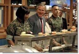 President George W. Bush and Mrs. Bush are served lunch with Marines at Camp Lejeune in Jacksonville, N.C., Thursday, April 3, 2003.   White House photo by Paul Morse