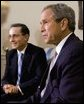 President George W. Bush and President of Colombia Alvaro Uribe take questions from the press in the Oval Office Wednesday, April 30, 2003. White House photo by Tina Hager