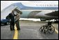 President George W. Bush talks with USA Freedom Corps Greeter Dan Yeric in front of Air Force One at Akron Canton Regional Airport in Canton, Ohio, Friday Oct. 22, 2004. Dan has been a volunteer at Akron Children's Hospital for the past 12 years and a patient at the hospital intermittently since he was diagnosed with spina bifida as an infant. White House photo by Eric Draper.