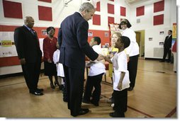 President George W. Bush visits with children at YMCA Anthony Bowen in Washington, D.C., Tuesday, Feb. 13, 2007. White House photo by Eric Draper