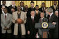 """President George W. Bush draws a laugh from the Miami Heat as the 2006 NBA champs visited the White House Tuesday, Feb. 27, 2007. """"This is a championship team on the court, and this is a championship team off the court,"""" said the President. """"And it is my high honor to welcome them to the White House as NBA champs."""" White House photo by Eric Draper"""