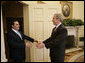 President George W. Bush reaches out to welcome President Elias Antonio Saca of El Salvador to the Oval Office Tuesday, Feb. 27, 2007. The leaders met for nearly an hour and discussed a number of topics, including an upcoming trade agreement between their countries, biofuels and the Millennium Challenge Account. White House photo by Eric Draper