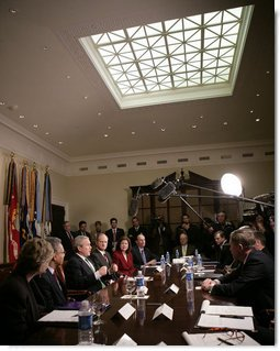 President George W. Bush talks to reporters during a meeting on health care initiatives in the Roosevelt Room at the White House, Tuesday, Feb. 20, 2007.  White House photo by Eric Draper
