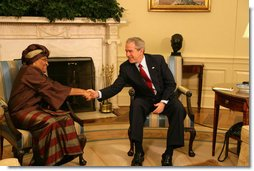 """President George W. Bush greets Liberia's President Ellen Johnson-Sirleaf during her visit Wednesday, Feb. 14, 2007, to the White House. President Bush applauded the leader's confidence and deep concern for the people of Liberia, saying, """"I thank you very much for setting such a good example for not only the people of Liberia, but for the people around the world, that new democracies have got the capability of doing the hard work necessary to rout out corruption, to improve the lives of the citizens with infrastructure projects that matter.""""  White House photo by Shealah Craighead"""