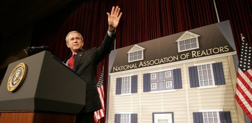 President George W. Bush waves as he arrives on stage Friday, May 13, 2005, at the Marriott Wardman Park Hotel in Washington, D.C., where he addressed the National Association of Realtors. White House photo by Paul Morse