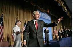 President George W. Bush waves after speaking at the National Catholic Prayer Breakfast in Washington, D.C., Friday, May 20, 2005.  White House photo by Eric Draper