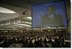 """President George W. Bush delivers remarks at the National Catholic Prayer Breakfast in Washington, D.C., Friday, May 20, 2005. """"This morning we also reaffirm that freedom rests on the self-evident truths about human dignity,"""" said the President. """"Pope Benedict XVI recently warned that when we forget these truths, we risk sliding into a dictatorship of relativism where we can no longer defend our values."""" White House photo by Eric Draper"""