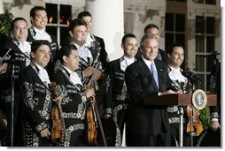 President George W. Bush delivers remarks during the White House celebration of Cinco de Mayo in the Rose Garden Wednesday, May 4, 2005.  White House photo by Paul Morse