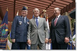 President George W. Bush stands with Ambassador John Negroponte and Lt. Gen. Michael Hayden after they were sworn in as the Director and Deputy Directory of National Intelligence at the New Executive Office Building Wednesday, May 18, 2005. White House photo by Paul Morse
