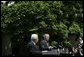 President George W. Bush and President Mahmoud Abbas of the Palestinian Authority, respond to questions during a joint press availability Thursday, May 26, 2005, in the Rose Garden of the White House. White House photo by Eric Draper