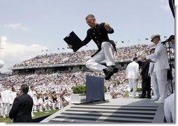 A U.S. Naval Academy graduate celebrates after receiving his diploma in Annapolis, Md., Friday, May 27, 2005.  White House photo by Paul Morse