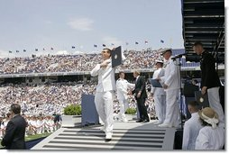 After addressing the Midshipmen and their families, President George W. Bush greets each graduate as they receive their diplomas during the U.S. Naval Academy graduation in Annapolis, Md., Friday, May 27, 2005.  White House photo by Paul Morse