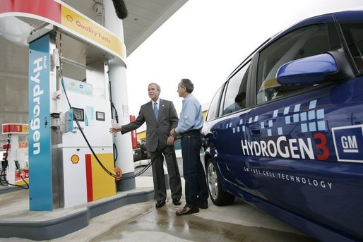 President George W. Bush talks to the media as he stands with Rick Scott, Operations and Safety Coordinator, Shell Hydrogen, L.L.C., Wednesday, May 25, 2005, at a Washington D.C. Shell Station, the first integrated gasoline/hydrogen station in North America. White House photo by Paul Morse