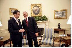 President George W. Bush talks with Prime Minister Anders Fogh Rasmussen of Denmark in the Oval Office Friday, May 20, 2005. White House photo by Eric Draper