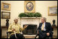 President George W. Bush greets former President Nelson Mandela of South Africa in the Oval Office Tuesday, May 17, 2005. White House photo by Eric Draper