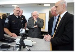 Vice President Dick Cheney, Senator Saxby Chambliss, and Department of Homeland Security Secretary Michael Chertoff listen as a U.S. Customs and Border Protection agent shows off some of the technology being used to train law enforcement personnel at the Federal Law Enforcement Training Center in Glynco, Georgia, May 2, 2005. The Vice President toured the facility, which provides training to more than 80 federal agencies, in addition to state and local police. The facility is the largest law enforcement training establishment in the country and graduates over 50,000 students annually.  White House photo by David Bohrer
