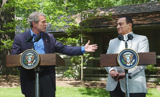 """President George W. Bush speaks during a press conference with Egyptian President Hosni Mubarak after their meeting at Camp David, Saturday, June 8. President Bush said """"We spent time talking about the Middle East and we share a common vision of two states living side by side in peace. And I appreciated so very much listening to his ideas as to how to achieve that objective."""" White House photo by Eric Draper."""