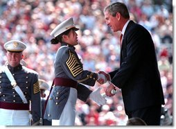 President Bush presents a diploma to a United States Military Academy graduate at West Point, N.Y. Saturday, June 1. White House photo by Paul Morse.