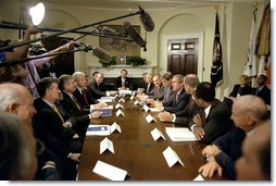 "Addressing the media, President George W. Bush meets with corporate leaders in the Roosevelt Room June 13. ""You know, there's been a lot of talk about corporate responsibility here in America, and there needs to be,"" said the President. ""People who run their businesses need to do so in a way that treats their employees with respect, and treats the communities in which they live with respect, as well."" White House photo by Paul Morse."