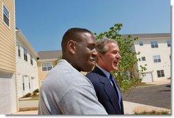 President George W. Bush and new home owner Al Smith tour Pryor Road Corridor Development in Atlanta, Georgia, Monday, June 17. White House photo by Eric Draper.