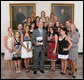 President George W. Bush stands with members of the University of Georgia Women's Gymnastics team, Tuesday, June 24, 2008, during a photo opportunity with the 2007 and 2008 NCAA Sports Champions at the White House. White House photo by Chris Greenberg