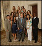 President George W. Bush stands with members of the UCLA Women's Tennis team, Tuesday, June 24, 2008, during a photo opportunity with the 2007 and 2008 NCAA Sports Champions. White House photo by Eric Draper