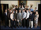President George W. Bush stands with members of the Pennsylvania State University Men's Volleyball team on Tuesday, June 24, 2008, in the Blue Room of the White House during a photo opportunity with the 2007 and 2008 NCAA Sports Champions. White House photo by Eric Draper