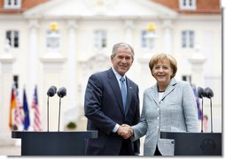 President George W. Bush and Germany's Chancellor Angela Merkel shake hands after participating in a joint press availability Wednesday, June 11, 2008, at Schloss Meseberg in Meseberg, Germany. White House photo by Eric Draper