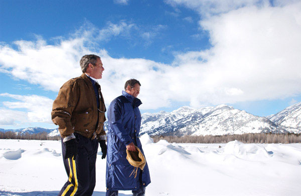 President George W. Bush and friend Roland Betts walk a private trail along the Snake River in Jackson Hole, Wyoming, Saturday, Feb. 9, 2002. The President and Mrs. Bush are staying at the Jackson Hole residence of Roland and Lois Betts. The Grand Teton Mountains are shown in background. White House photo by Eric Draper.
