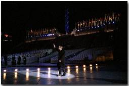 President George W. Bush waves to the crowd as he walks across the ice during the opening ceremonies for the 2002 Winter Olympic Games in Salt Lake City, Utah, Feb. 8. White House photo by Eric Draper.