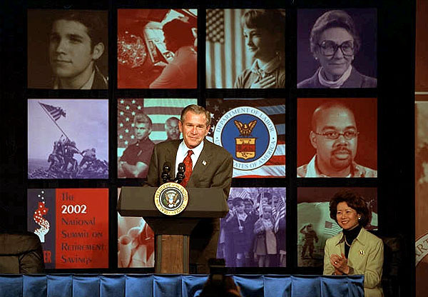 """President George W. Bush addresses the 2002 National Summit on Retirement Savings Feb. 28. """"Government must support policies that promote and protect saving,"""" said the President. """"And saving is the path to independence for Americans in all phases of life, and we must encourage more Americans to take that path."""" White House photo by Paul Morse."""