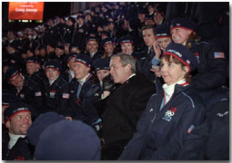 Taking a phone call from an athlete's family, President George W. Bush sits with America's Olympic athletes during the opening ceremonies for the 2002 Winter Olympic Games in Salt Lake City, Utah, Feb. 8. White House photo by Paul Morse.