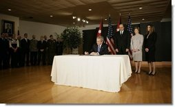 President George W. Bush signs a book of condolence, Thursday, Nov. 10, 2005 at the Embassy of Jordan in Washington, in remembrance of those killed in the terrorist attacks, Wednesday, in Jordan.  White House photo by Eric Draper