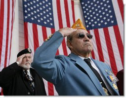 Veterans Jose Garcia, right, and John Rowan, salute Friday, Nov. 11, 2005, during Veterans Day ceremonies at Arlington National Cemetery in Arlington, Va. White House photo by David Bohrer