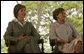 Mrs. Laura Bush and Mrs. Marisa Leticia da Silva listen to remarks by their husbands, during a joint statement at Granja do Torto, home of Brazil President Luiz Inacio Lula da Silva, Saturday, Nov. 6, 2005. White House photo by Paul Morse
