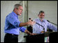 President George W. Bush speaks during a joint press statement with Brazilian President Luiz Inacio Lula da Sliva at the Granja do Torto in Brasilia, Brazil, Sunday, Nov. 6, 2005. White House photo by Paul Morse