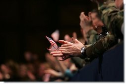 An American flag is highlighted in the crowd Monday, Nov. 14, 2005, as President George W. Bush speaks at Elmendorf Air Force Base in Anchorage on the War on Terror.  White House photo by Shealah Craighead