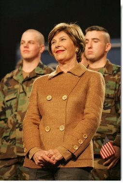 Mrs. Laura Bush smiles as she listens to the President's introduction Monday, Nov. 14, 2005, at Elmendorf Air Force Base in Anchorage, Alaska, where he delivered remarks on the War on Terror to the troops.  White House photo by Shealah Craighead