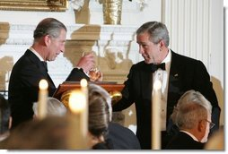 President George W. Bush and the Prince of Wales toast one another during a dinner at the White House, Wednesday evening, Nov. 2, 2005.  White House photo by Krisanne Johnson