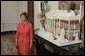 Laura Bush stands before the White House gingerbread house , Wednesday, Nov. 30, 2005, as she answers questions during the press preview of the White House Christmas decorations. White House photo by Shealah Craighead