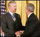 President George W. Bush shakes the hand of Gen. Richard Myers, recently retired Commander of the Joint Chiefs of Staff, after presenting him with the Presidential Medal of Freedom during ceremonies Wednesday, Nov. 9, 2005, at the White House. White House photo by Paul Morse